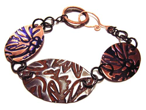 Bracelet shows Copper Blanks with Violet Kuretake Alcohol Ink and Vintaj Arte Metal with Rust Gilders Paste